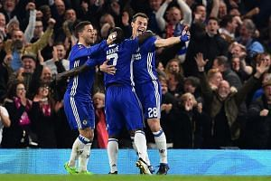 Chelsea midfielder N'Golo Kante (centre) celebrating with teammates Eden Hazard (left) and Cesar Azpilicueta (right) after scoring the opening goal of the English FA Cup quarter final football match between Chelsea and Manchester United.