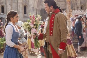 Gaston (Luke Evans) is relentless in his pursuit of Belle (Emma Watson) in Disney's Beauty And The Beast.