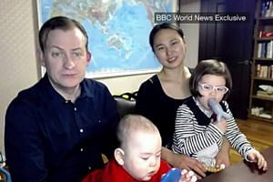 Prof Kelly, his wife and children appear in a BBC interview to explain their reaction to the viral video.