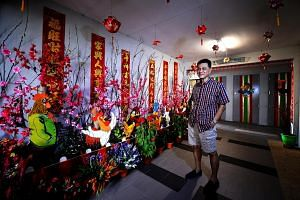 Mr Tham creates displays at the lift lobby outside his flat in Dover Crescent to mark festivals. He keeps fire-retardant paint and a fire extinguisher at hand and has not encountered problems with the authorities.