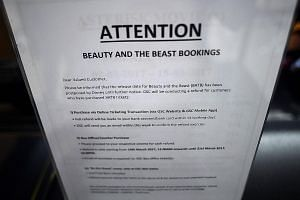 """A notice put up at a Golden Screen Cinemas theatre in Kuala Lumpur regarding the """"postponed"""" release of the Disney movie, Beauty And The Beast, and ticket refunds."""