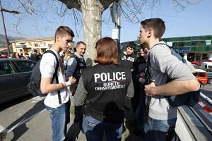 A policewoman talks with students near the Tocqueville high school in the southern French town of Grasse.