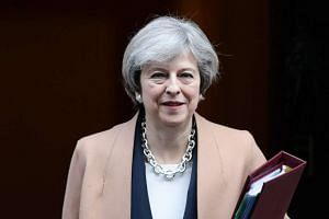 British Prime Minister Theresa May leaving 10 Downing Street to attend the weekly question-and-answer session in the House of Commons on Wednesday (March 15).