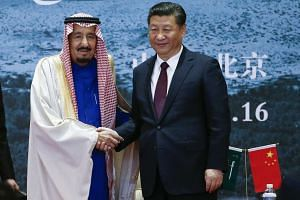 Chinese President Xi Jinping (right) and Saudi Arabia's King Salman bin Abdulaziz Al Saud attending the closing ceremony of the exhibition of artefacts at China National Museum in Beijing on March 16, 2017.