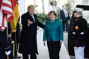 US President Donald Trump welcomes German Chancellor Angela Merkel at the White House.