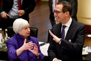 US Treasury Secretary Steve Mnuchin speaks with US Federal Reserve chairman Janet Yellen at the meeting.