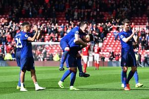 Manchester United players celebrate after the Middlesbrough vs Manchester United Premier League match on March 19, 2017.