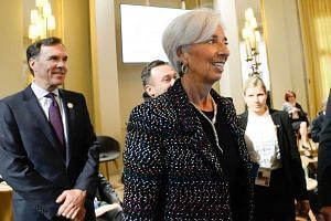 IMF chief Christine Lagarde arrives for a symposium at the G-20 meeting, on March 17, 2017.