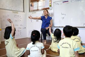Teacher Connie Heng engages her charges with an activity at Eshkol Valley Preschool. The operator has 20 staff, including 10 teachers, and staff turnover is low.