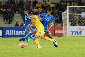 The LionsXII (in blue) and Pahang players in action during their Malaysia Cup quarter-final first leg match at the Darulmakmur Stadium in Kuantan on Nov 24, 2015.