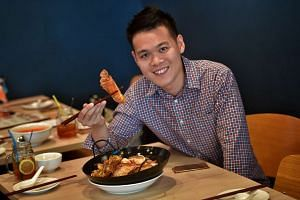 "Mr Cedric Chng, owner of zi char restaurant Big Lazy Chop, with its signature ""Indo"" Curry Combo Beehoon, which comes with crayfish."