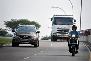 ST executive photojournalist Seah Kwang Peng, who has eight years of riding experience, says motorcyclists often have to stop wherever they can - shelter or no shelter - and put on their raincoats quickly.