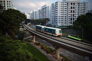 A train arrives at Bukit Panjang LRT Station.