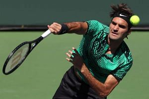 Roger Federer of Switzerland (above) serves against Jack Sock of United States during their semi finals match at the 2017 BNP Paribas Open tennis tournament at the Indian Wells Tennis Garden in Indian Wells, California, USA on March 18, 2017.