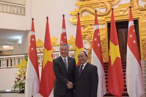 Prime Minister Lee Hsien Loong meets his Vietnamese counterpart Nguyen Xuan Phuc at the Presidential Palace in Hanoi, Vietnam, on March 23, 2017.