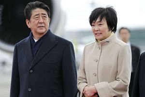Japanese Prime Minister Shinzo Abe (left) and his wife Akie.