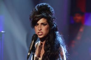 Bob Dylan has hailed Amy Winehouse (pictured) as the last great artist with an individual style.