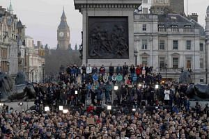 People attending a vigil in Trafalgar Square the day after an attack, in London, Britain, on March 23, 2017.