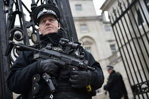 An armed policeman stand guards in Westminster, near to the scene of incidents on 22 March in central London, Britain on March 24, 2017.