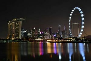 The Marina Bay skyline darkens for Earth Hour at 8.35pm on March 25, 2017.