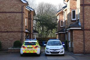 Two police cars are parked inside a gated housing estate connected to Westminster terrorist Khalid Masood which was raided overnight by anti-terror police, on March 24, 2017.