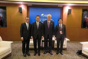 ESM Goh Chok Tong (second from right) and Hong Kong's Chief Executive Leung Chun Ying (second from left) met on the sidelines of the forum yesterday. Also in the picture are Hong Kong's Financial Secretary Paul Chan (far left) and Singapore's Ambassa