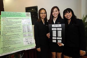 Singapore Polytechnic students (from left) Serena Song, Lau Xue Ru and Rachel Chua showcasing the project's details last Wednesday.