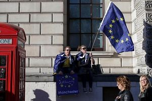 Demonstrators waving an EU flag during a rally following an anti-Brexit, pro-European Union march in London, on March 25, 2017.