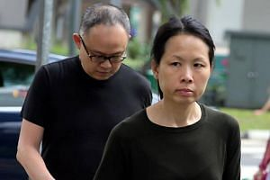 Chong Sui Foon (front) and Lim Choon Hong, arriving at the State Courts on Monday (March 27).