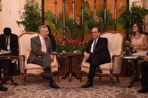 French President Francois Hollande meets Prime Minister Lee Hsien Loong at the Istana.
