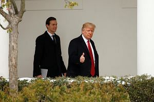 US President Donald Trump giving a thumbs-up as he and White House Senior Advisor Jared Kushner depart the White House in Washington, US, on March 15, 2017.