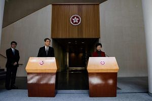 Hong Kong's chief executive-elect Carrie Lam (right) and Chief Executive Leung Chun Ying speaking during a press conference in Hong Kong on March 27, 2017.