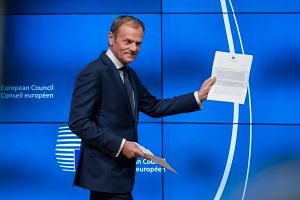 European Council President Donald Tusk waved papers as he began a short statement about the notification from British Prime Minister Theresa May triggering Article 50.