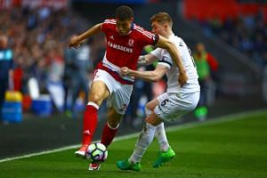 Middlesbrough's Rudy Gestede (left) vies with Swansea City's Alfie Mawson during the EPL match on April 2, 2017.