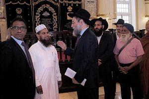 Imam Nalla Mohamed Abdul Jameel speaking to Rabbi Mordechai Abergel at the Maghain Aboth Synagogue yesterday, where he extended his unconditional apology and said he must bear full responsibility for his actions.
