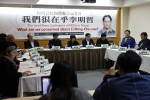 Members of Taiwan's civic groups holding a news conference to call for China's release of Taiwanese pro-democracy activist Li Ming-che, in Taipei, Taiwan, on April 1, 2017.