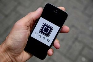 The Uber app logo is seen on a mobile telephone on October 28, 2016.