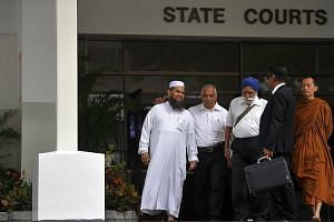 Imam Nalla Mohamed Abdul Jameel leaving court yesterday with religious leaders Haja Maideen of the United Indian Muslim Association, Harbans Singh and Phra Goh Chun Kiang, and lawyer Noor Mohamed Marican. In sentencing, the judge noted the imam's