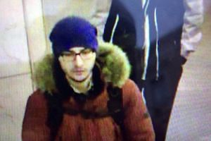 A still image allegedly showing bombing suspect Akbarzhon Jalilov walking at St Petersburg's metro station on April 3, 2017.