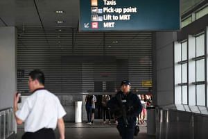 Shutters to Hougang MRT Station being raised after the station is deemed safe.