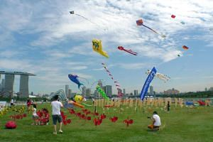 People flying kites at Marina Barrage.