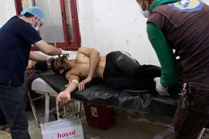 A video grabbed still image shows Syrian people receiving treatment after an alleged chemical attack at a field hospital.