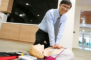 Prof Ong showing how to use an automated external defibrillator yesterday. He says Singapore still has some way to go in CPR training.