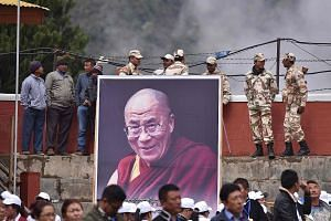 Large crowds turned out in Bomdila, a town in India's Arunachal Pradesh state, to welcome the Dalai Lama on Tuesday.