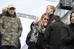 People react following the news that a truck reportedly crashed into a department store in central Stockholm, Sweden on April 7, 2017.