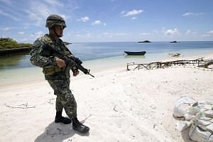 A Filipino soldier on Thitu Island in May 2015. Mr Duterte wants more barracks to be constructed on top of plans to build a new port, repave an airstrip and repair existing structures there.