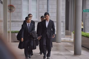 City Harvest Church founder and senior pastor Kong Hee arriving in court.