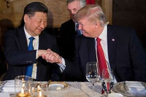 US President Donald Trump (left) with Chinese President Xi Jinping in Palm Beach, Florida.
