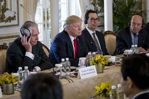 Mnuchin (third from left) with US President Donald Trump during a meeting with Chinese President Xi Jinping at Trump's Mar-a-Lago resort in Florida, April 7, 2017.