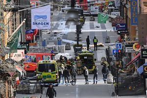 A general view of emergency services in central Stockholm after a truck crashed into a department store in central Stockholm, Sweden, on April 7, 2017.